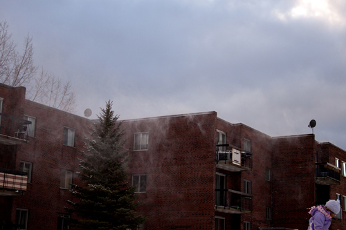 Crazy wind blowing snow off the roof